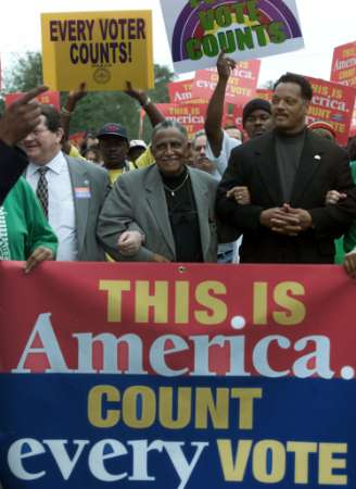 Jesse Jackson marches in protest